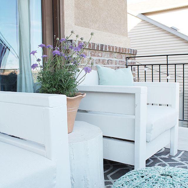 White outdoor chairs on a porch