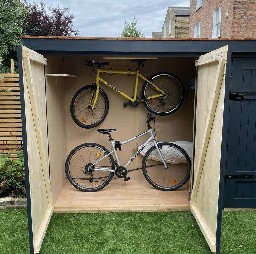 bikes inside a wooden shed painted navy