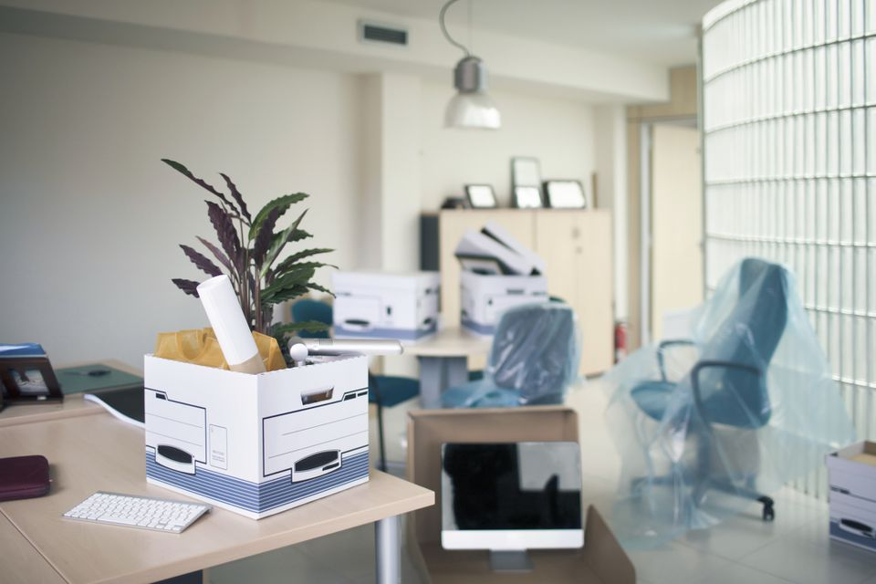 Belongings in box on desk in office