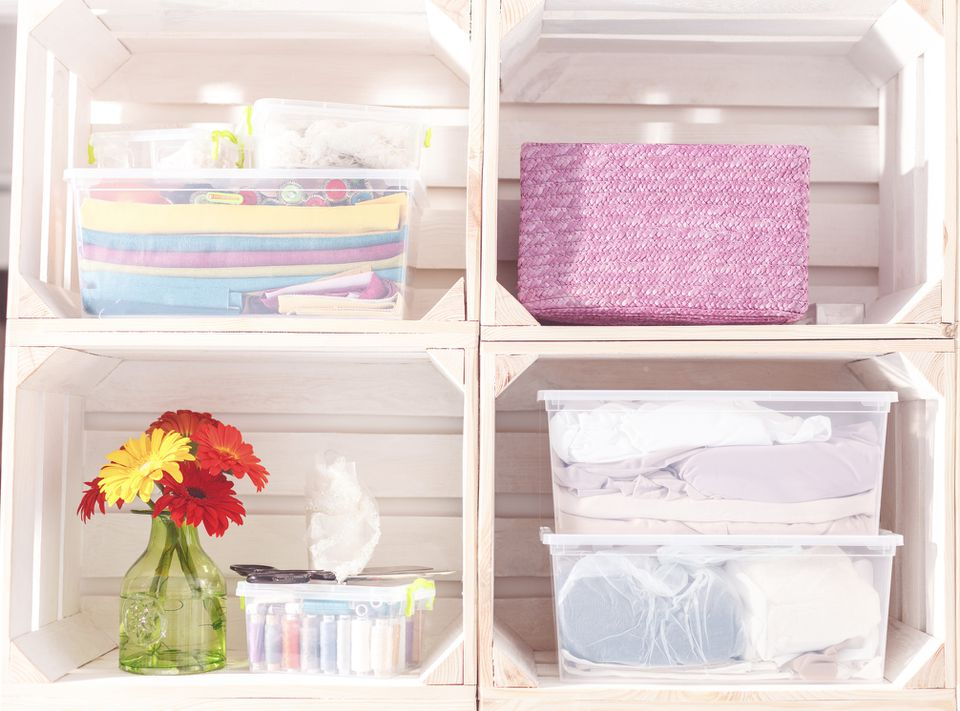 Plastic storage containers on shelves
