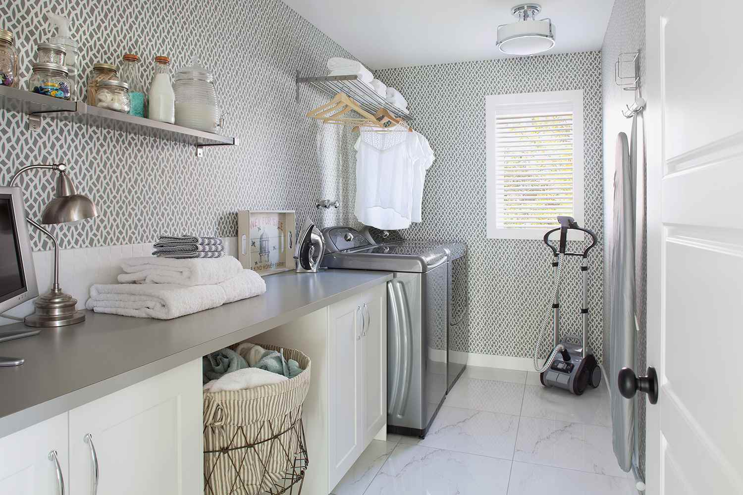 Interior of laundry room in a contemporary home with vinyl flooring.