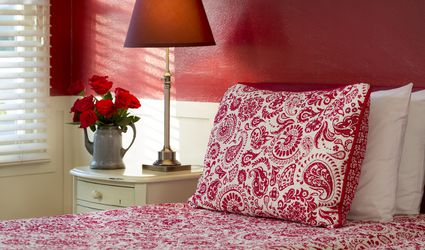 bedroom with red color wall and flowers