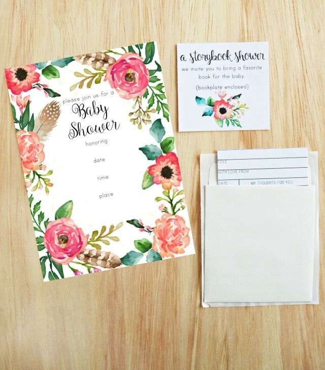 A floral baby shower invitation on a table