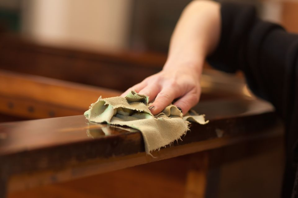 Hand cleaning wood furniture