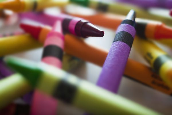 Crayons laid across a table