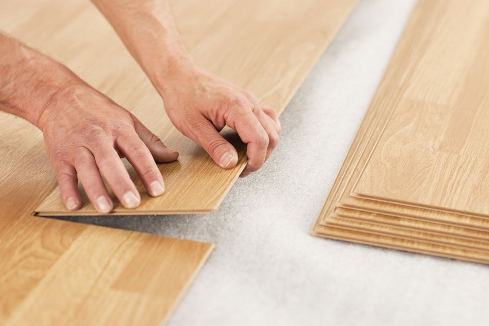 Person Laying Wood Laminate Floor