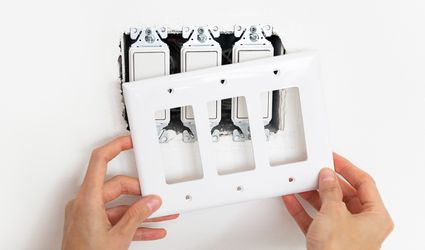 removing a light switch plate