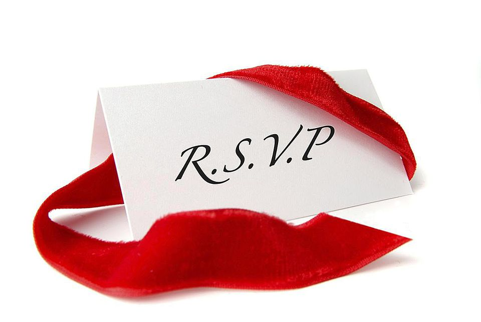 R.S.V.P on paper with a red ribbon around it