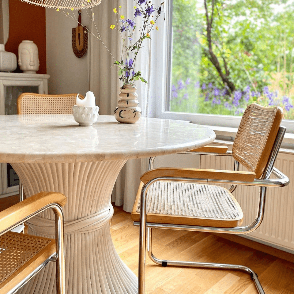Rattan chairs and pendant lamp in a dining room