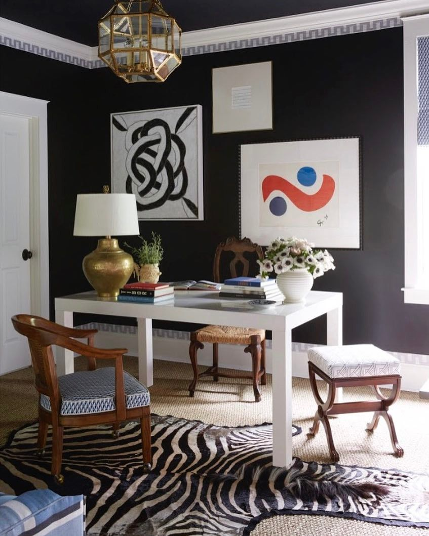 Office space with black walls and bright art