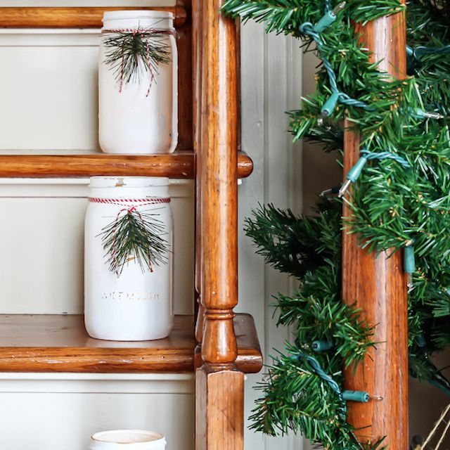 staircase with white mason jars - How To Decorate Stairs For Christmas