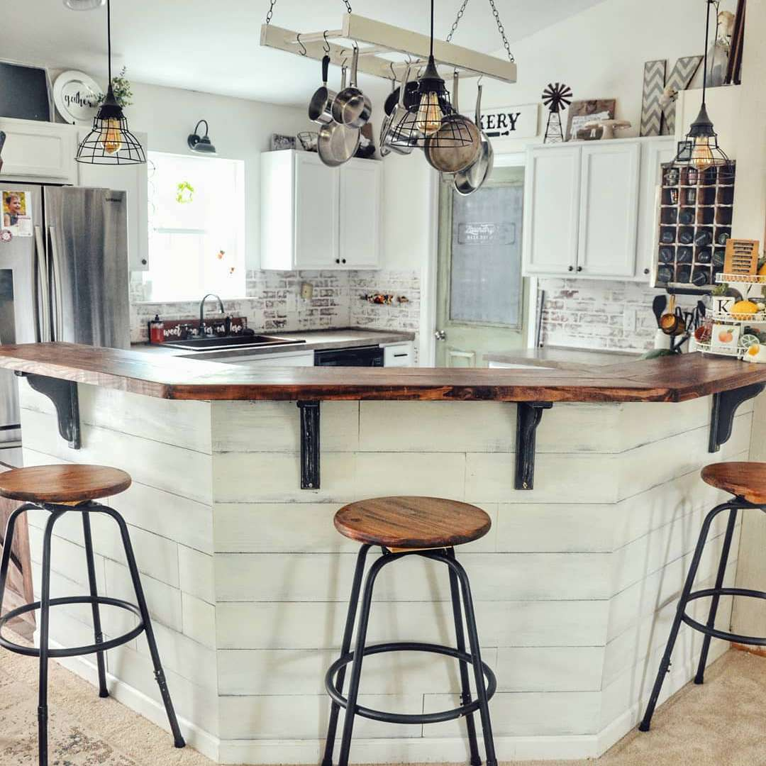 Kitchen with a large wrap around island
