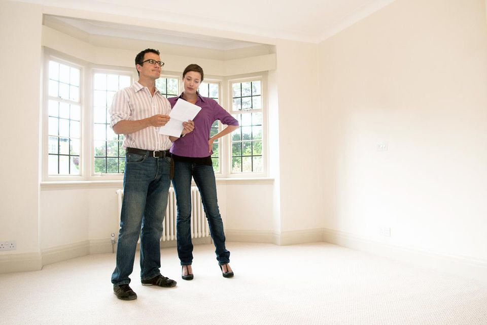 Couple look at a room in a vacant house