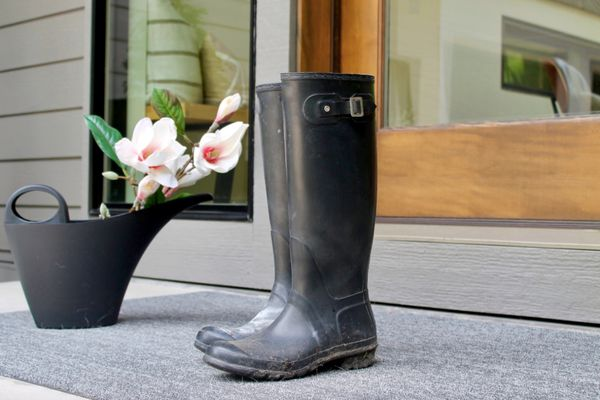 soiled wellies on a front porch