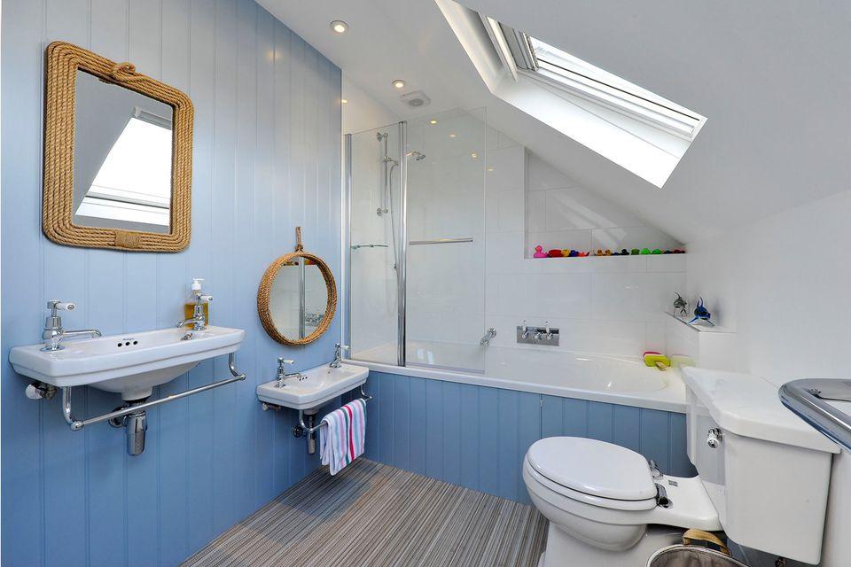 Nautical bathroom with kid-sized vanity