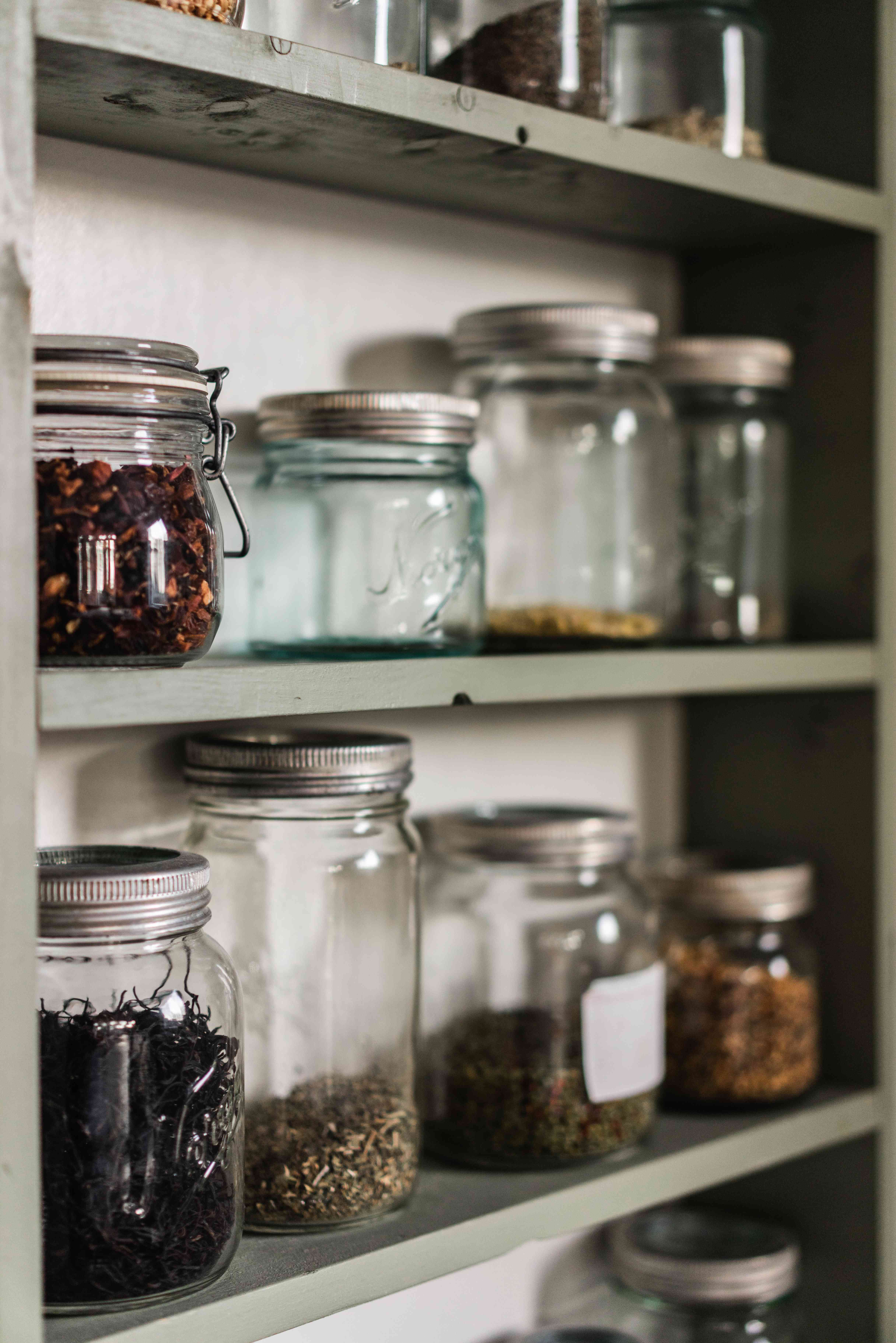 Pantry cabinets with spices in glass jars