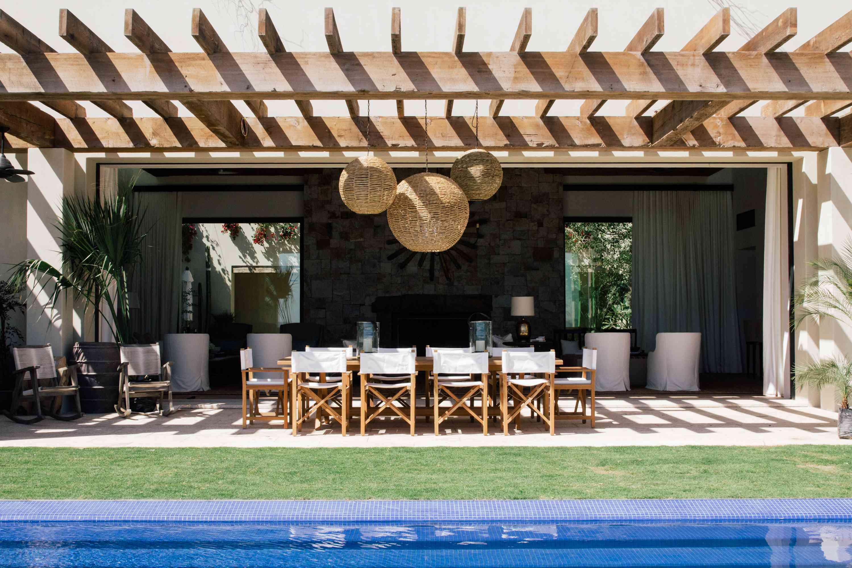 LA-based interior designer, Chris Barrett, designed this outdoor space, which features multiple zones for different purposes