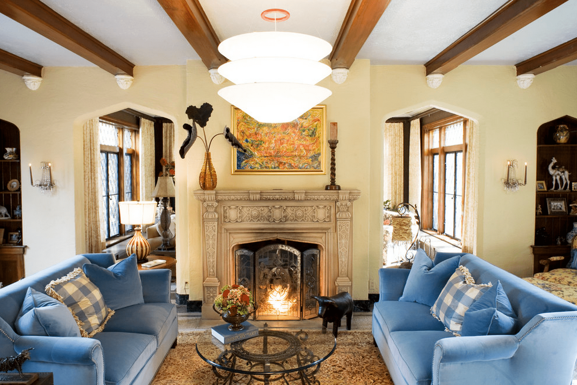 Living room with carved fireplace details