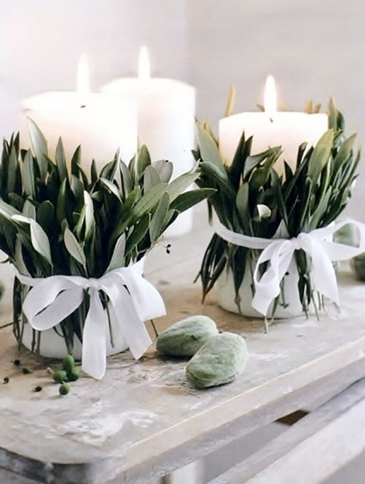 Candles wrapped with greenery