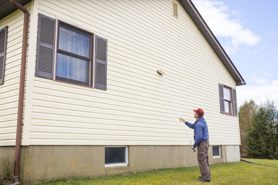 Man washing house siding