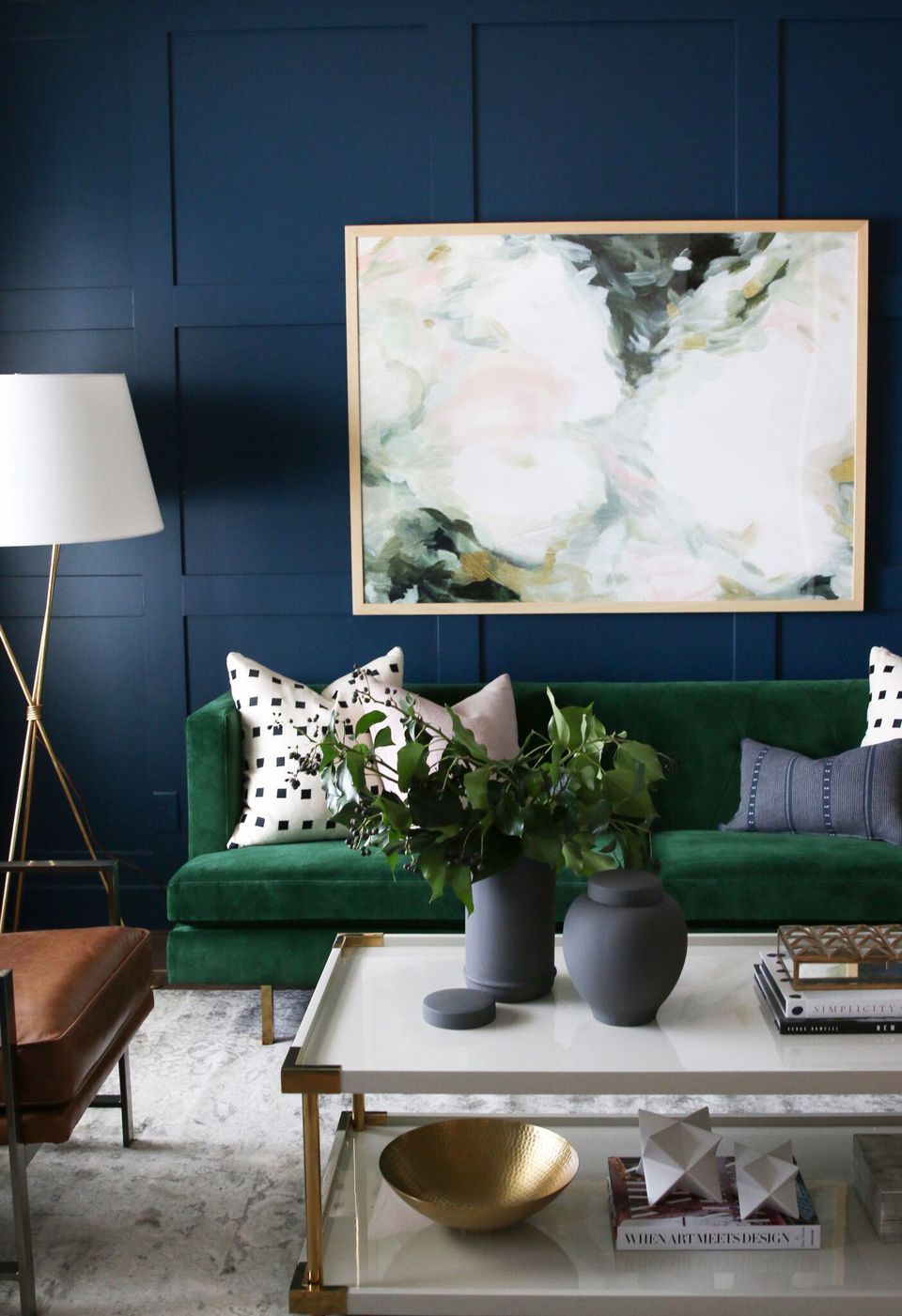 dark blue room with a green couch