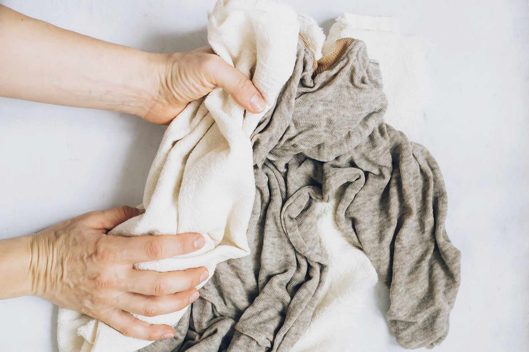 Someone drying a garment with a towel