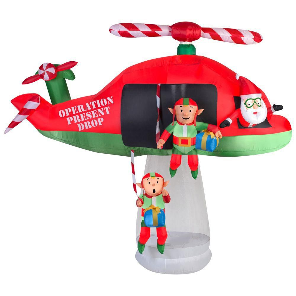Inflatable Santa and Elves in Helicopter Scene