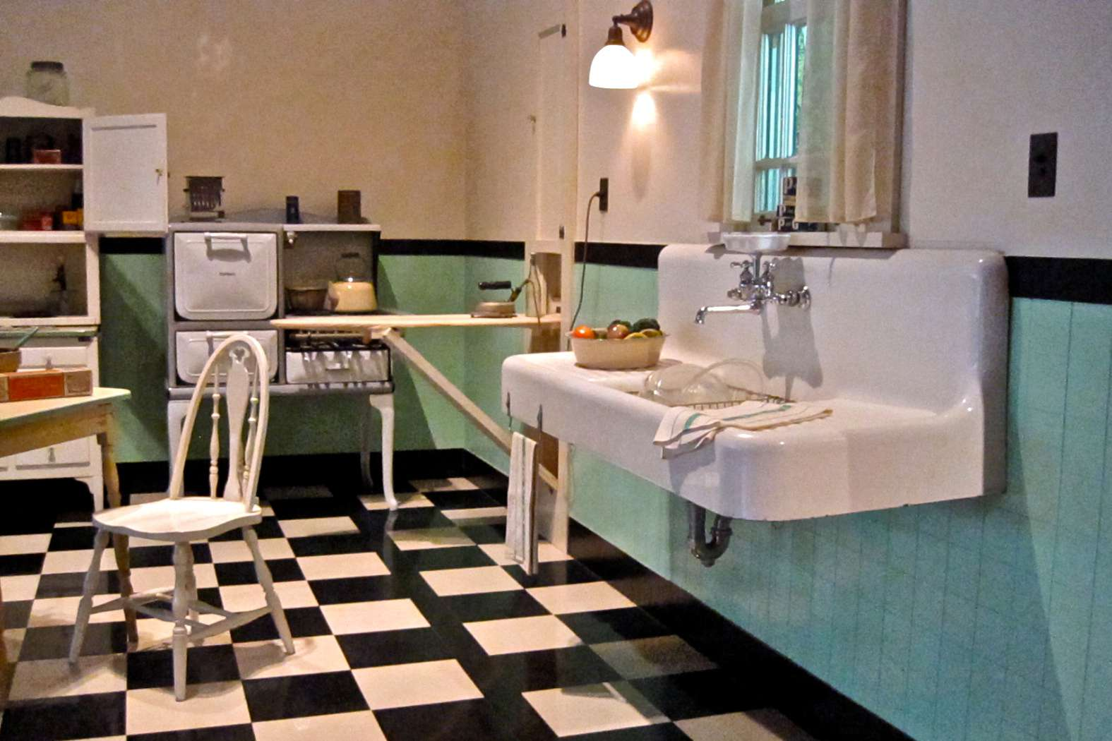 Vintage kitchen with a built-in ironing board cabinet.