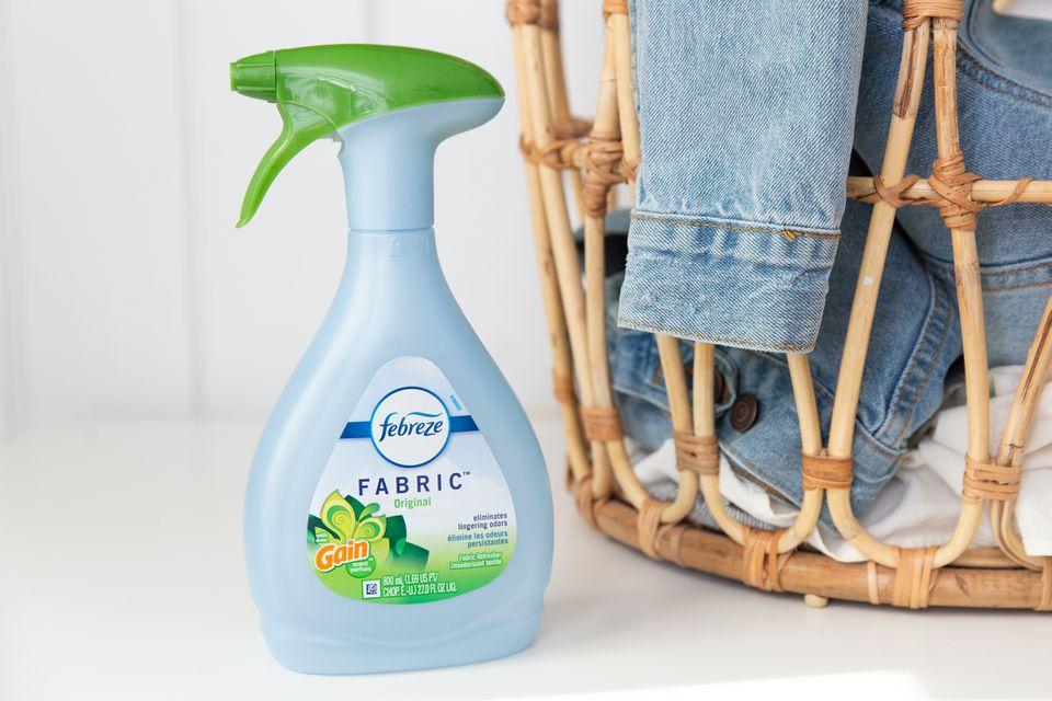 Febreze fabric refresher next to laundry basket