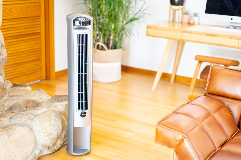 Air purifier tower with ionizer in living space