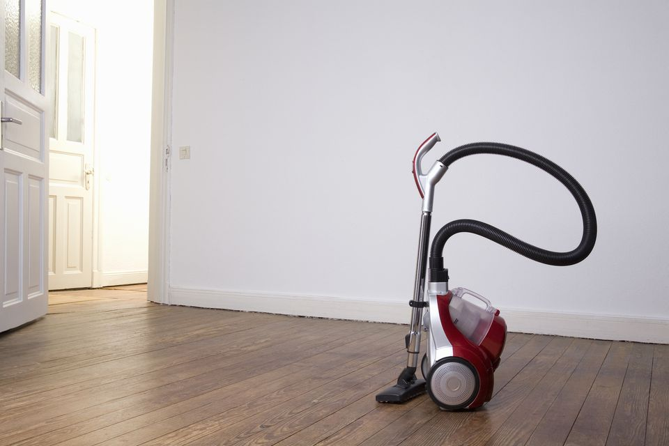 Vacuum cleaner in an empty room