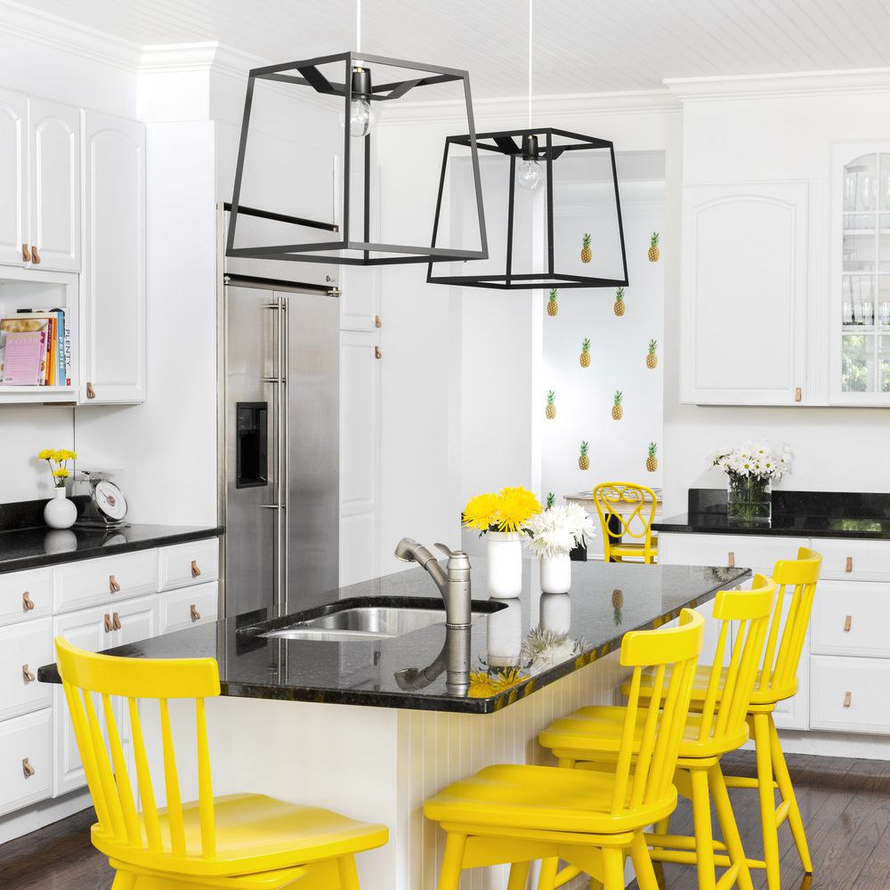 Pineapple kitchen with four yellow chairs.