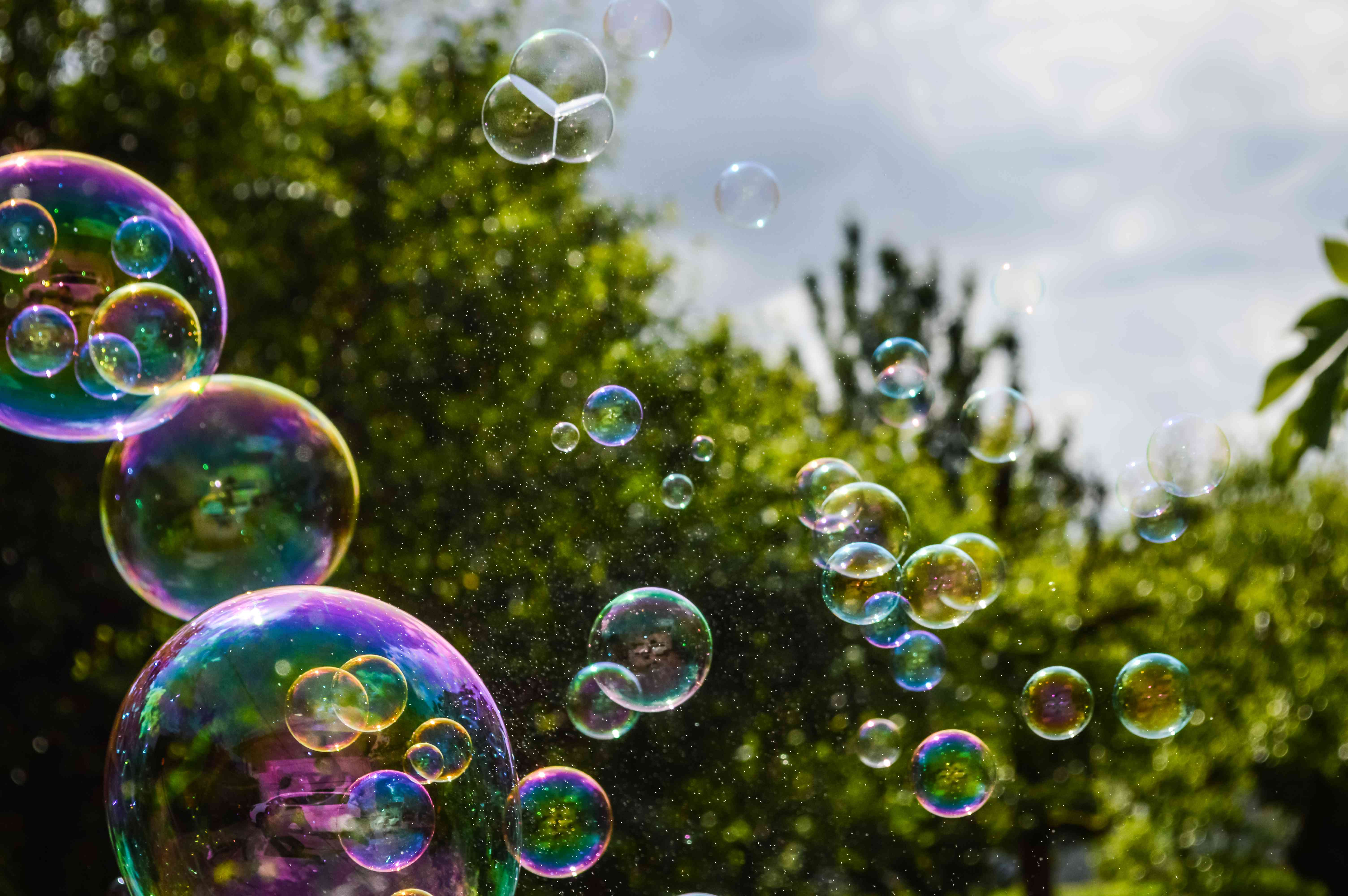soap bubbles floating on green garden background