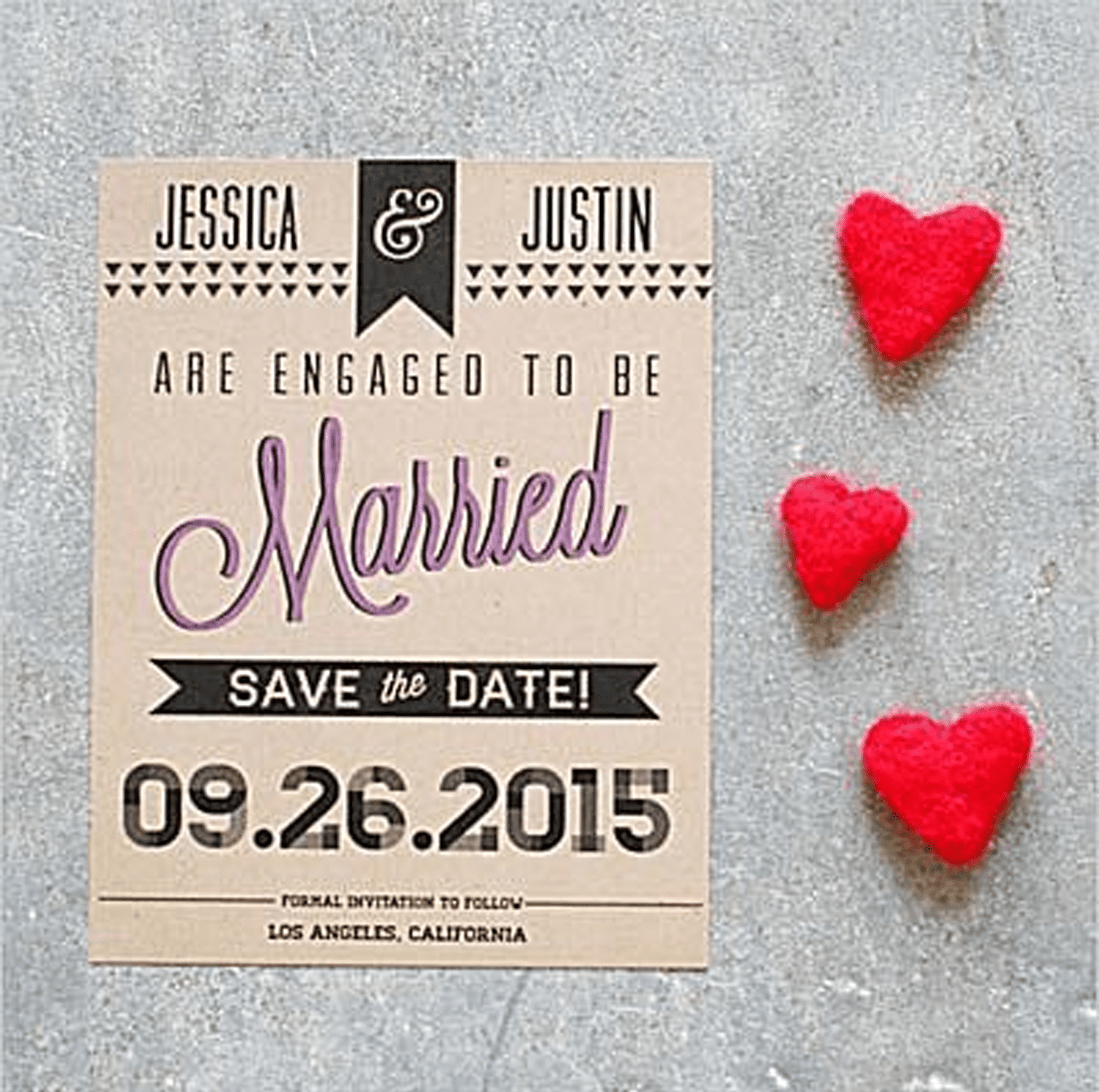 picture of a save the date card with red hearts