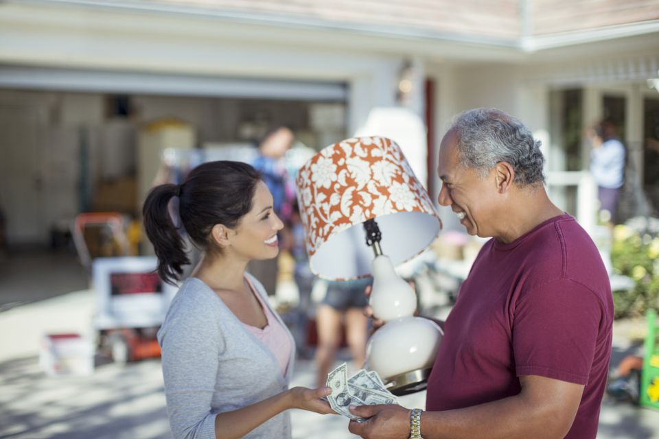 Man buying lamp at yard sale