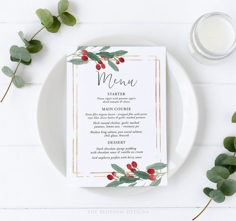 A menu laying on a plate with branches