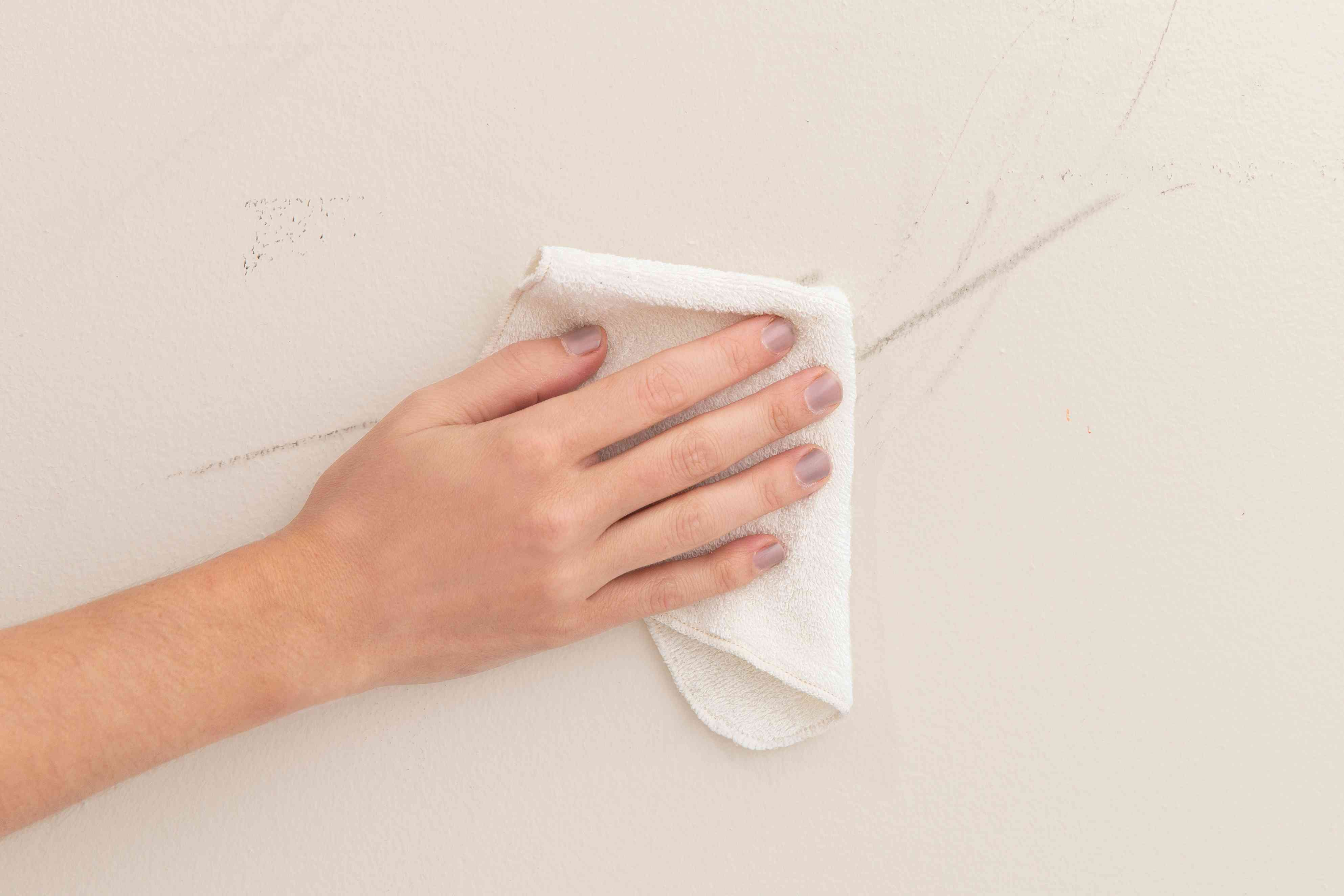 wiping scuff marks with a cloth and water