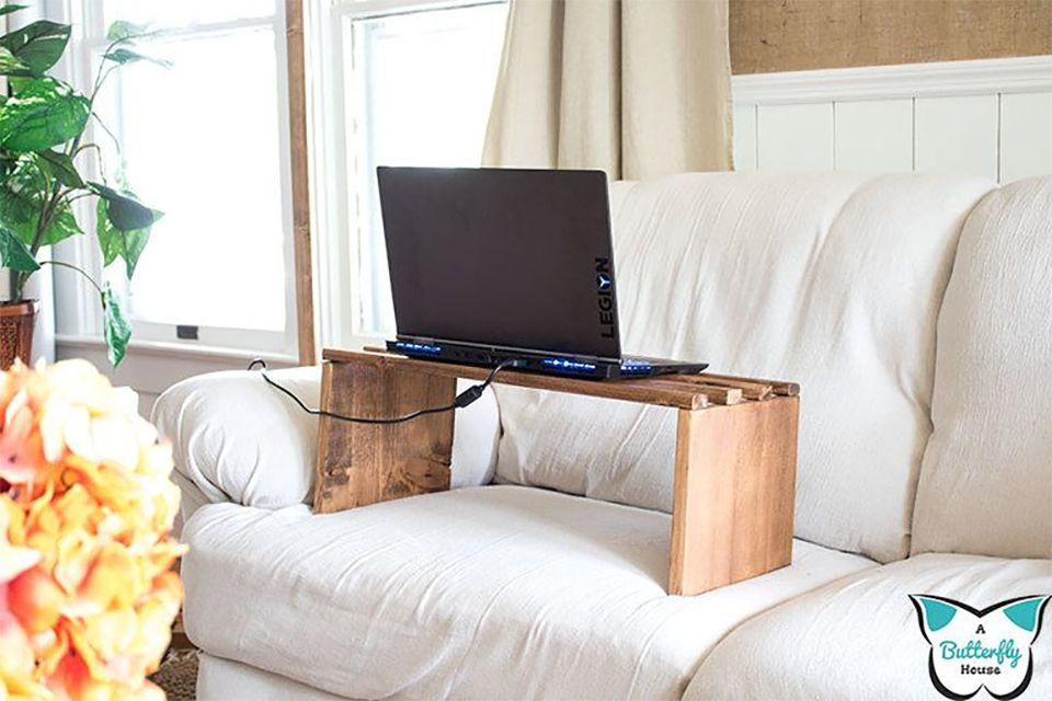 A wooden laptop stand on a couch