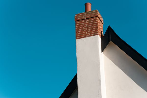 House roof with chimney flue