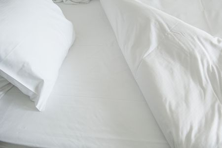 High Angle View Of Bed With Crisp White Sheets
