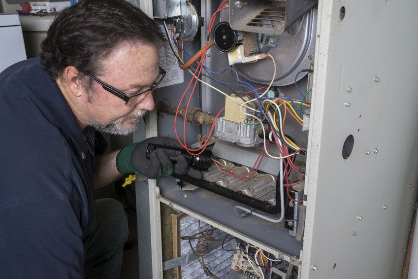 Furnace maintenence technician