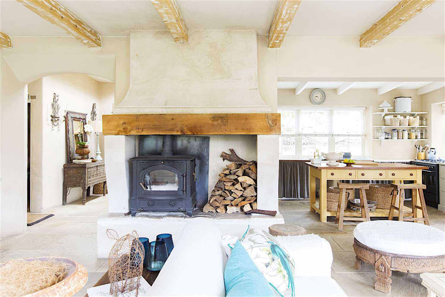 Clean bright common space with fireplace