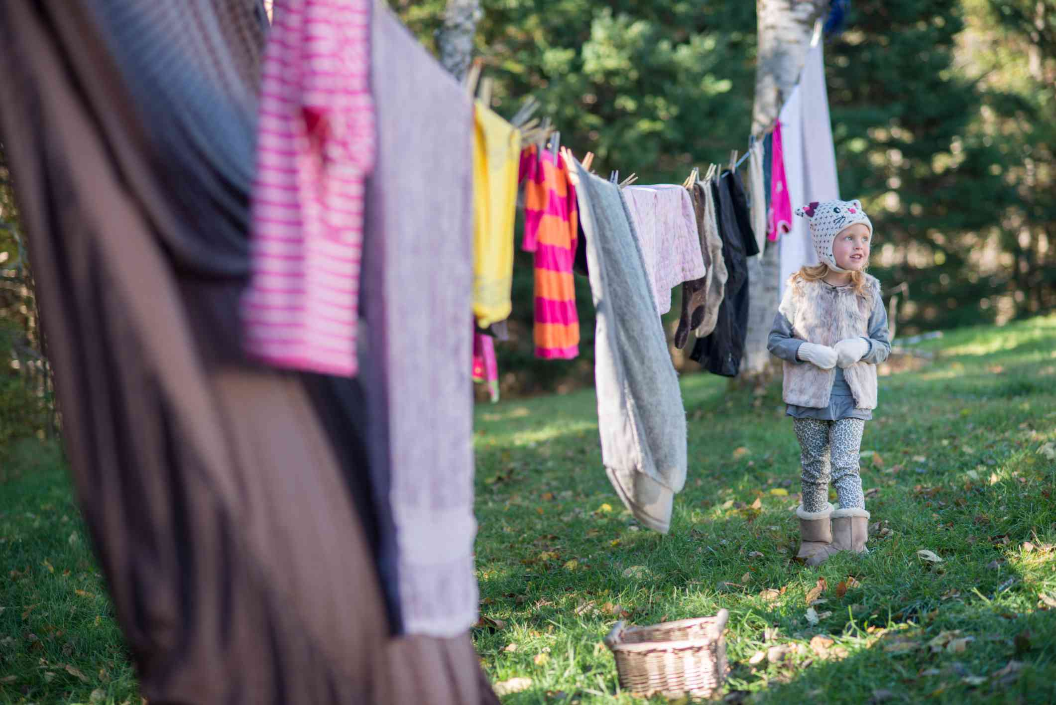 Girl Standing By Clothesline