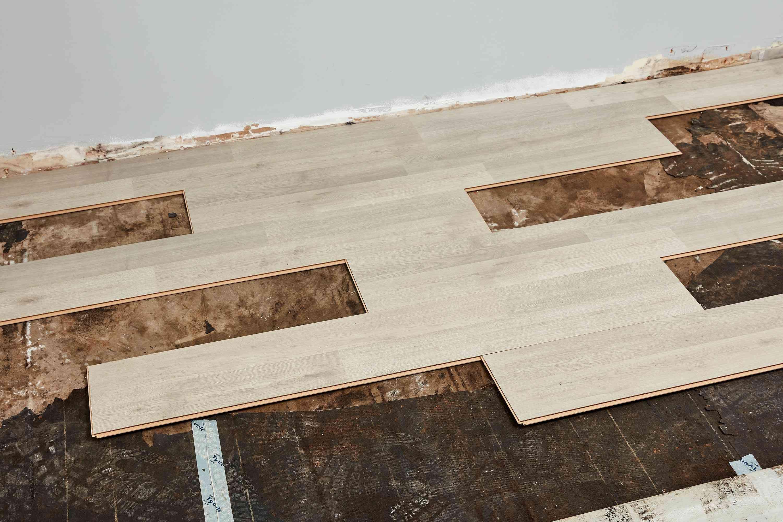 Laminate planks laid out on subfloor