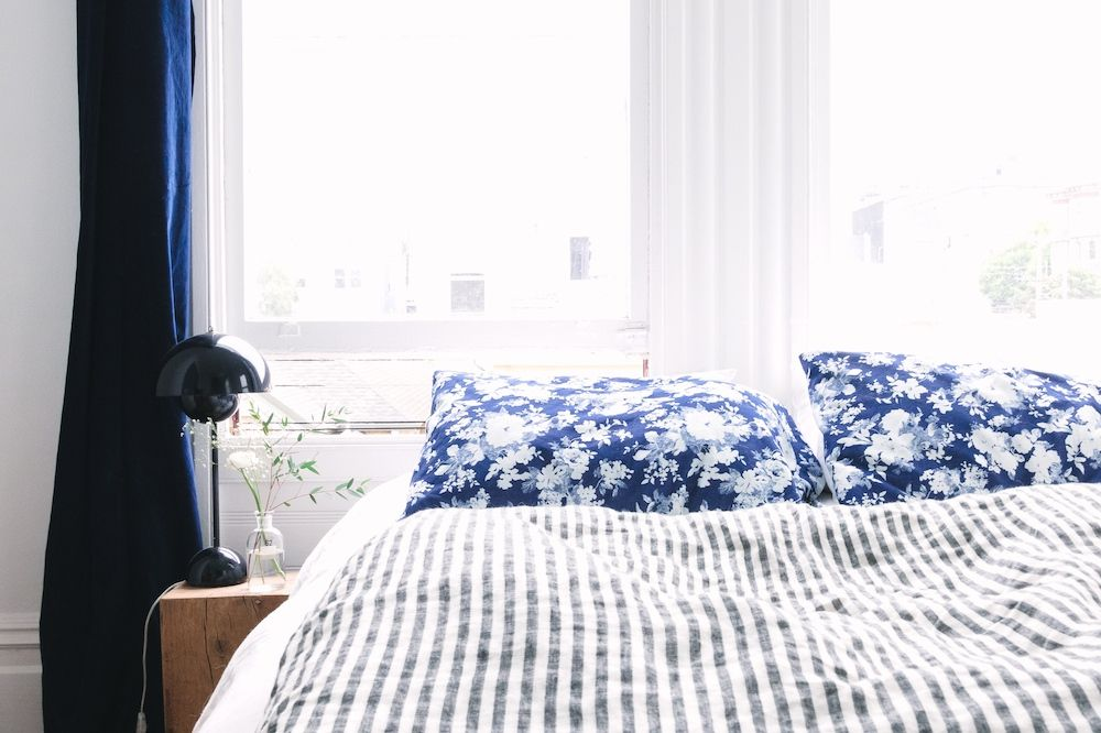 Navy and white bedroom.