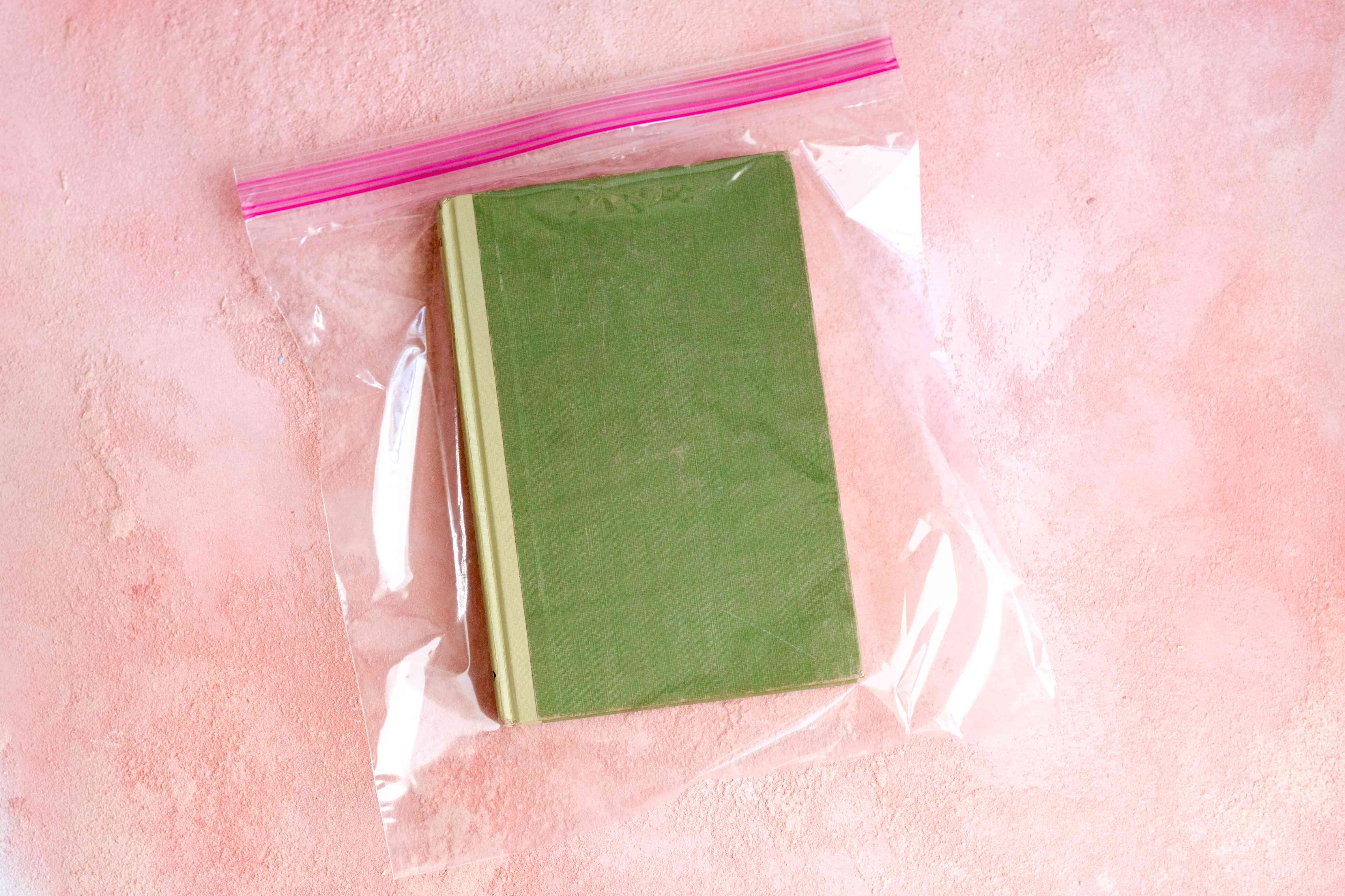 a book placed in a plastic storage bag