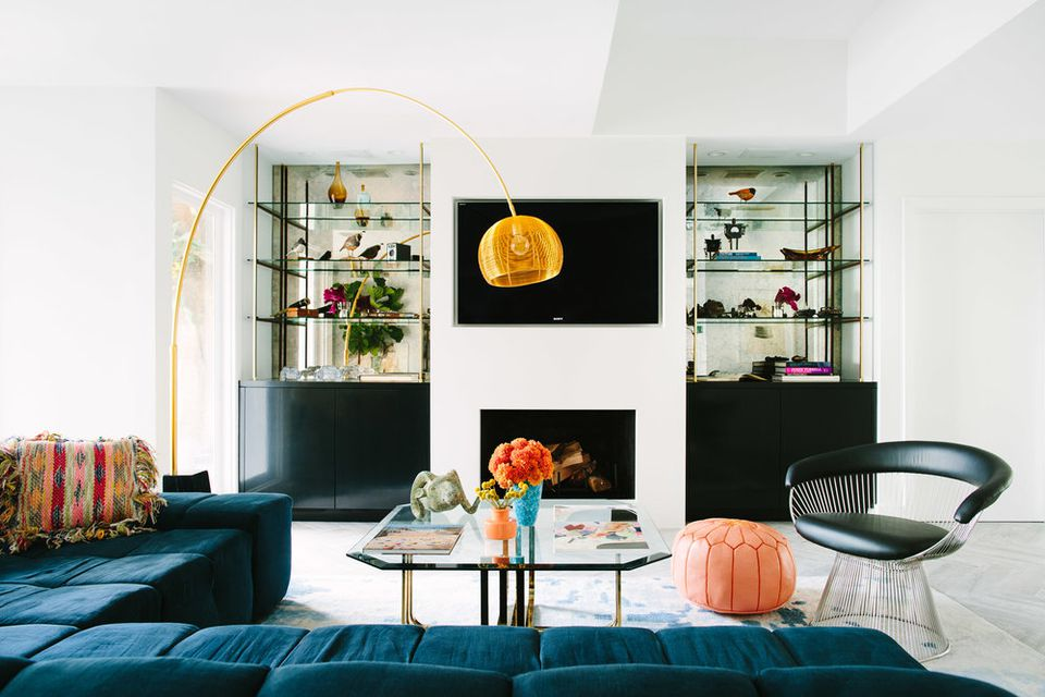 living space with a large arched lamp