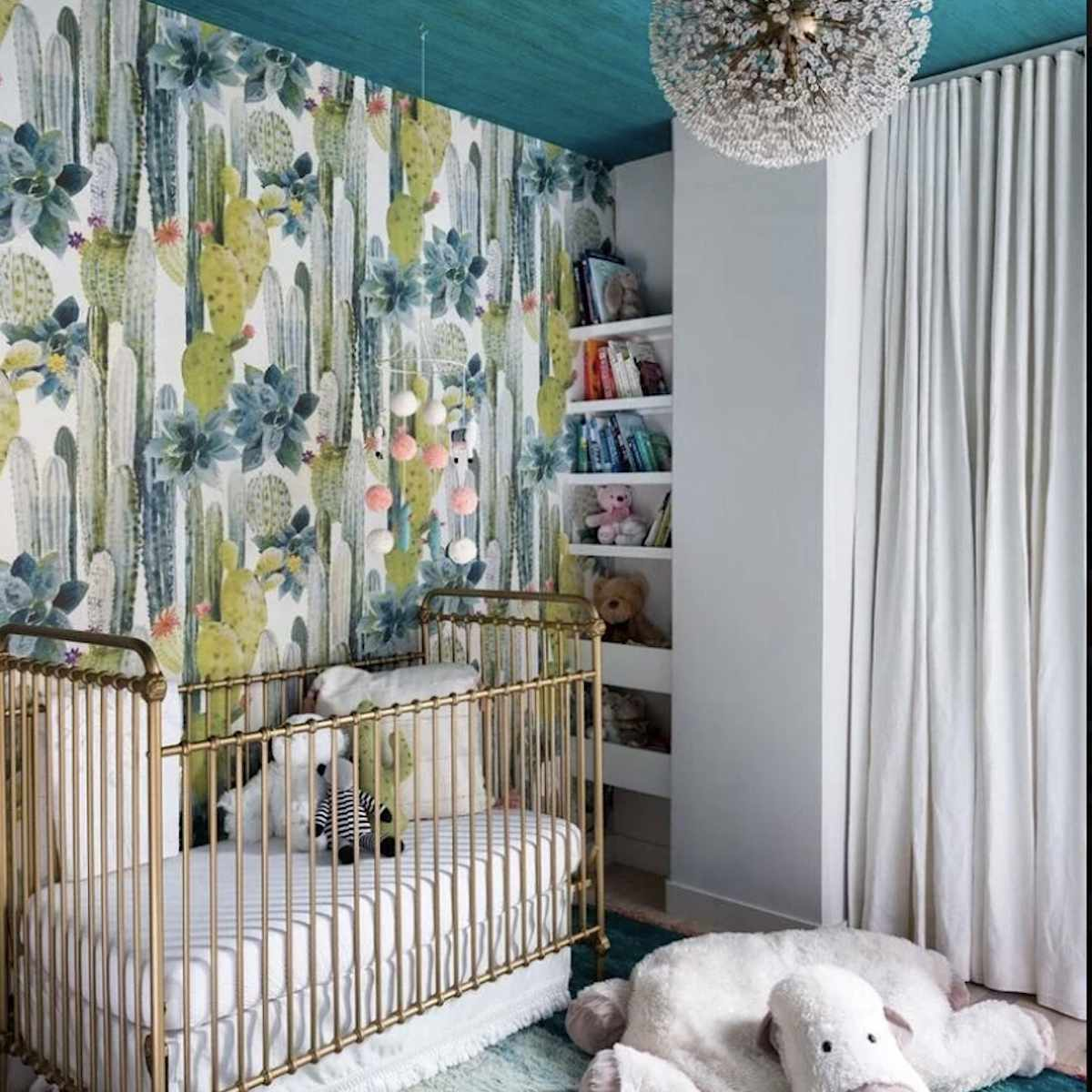 blue and green nursery with small nook that has built in shelves
