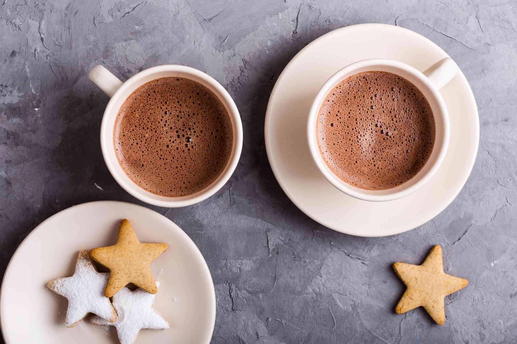 Plate of star shape Christmas cookies and hot chocolate