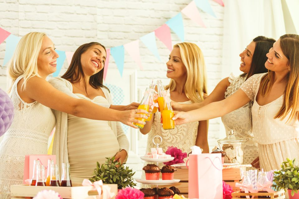 A group of women making a toast at a baby shower